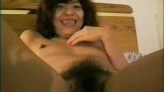 Lewd amateur Asian nympho tickles her bushy pussy and sucks dick